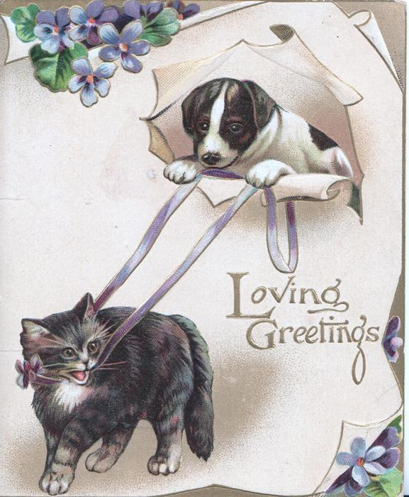 LOVING GREETINGS on plaque, puppy holds ribbons restraining cross kitten below