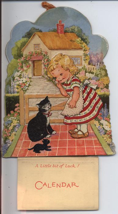 little girl, black cat and kitten by gate in front of cottage