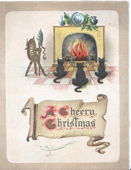 A CHEERY CHRISTMAS on pale brown plaque below 3 cats sitting facing a fire in fireplace, brown margins