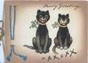 MERRY GREETINGS 2 smiling black cats with mistletoe collars sitting facing front XXXXXXX below