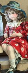 little girl holding riding crop