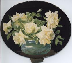 TIME OF ROSES white roses in blue rose bowl, black background