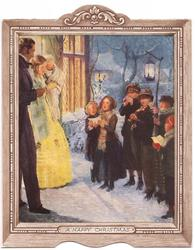 A HAPPY CHRISTMAS child carollers perform for family at door front, snow