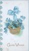 GOOD WISHES in gilt below gilt basket of forget-me-nots hanging from blue ribbon