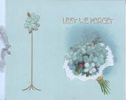 LEST WE FORGET in white/gilt above right, forget-me-nots below & left, pale blue background