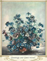 GREETINGS AND GOOD WISHES many blue cornflowers in vase
