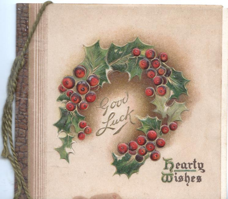 GOOD LUCK in gilt surrounded by berried holly, HEARTY WISHES in gilt below right