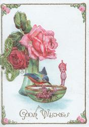 GOOD WISHES below pink & red roses in green vase above bluebird of happiness & manniken on edge of bowl