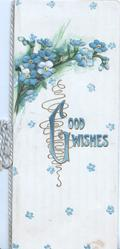 GOOD WISHES(G illuminated)in blue above forget-me-nots, pale grey striped & scant forget-me-not background