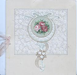 no front title, 2 red & a pink rose at centre of elaborate gilt & white design