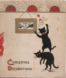 CHRISTMAS DECORATIONS(C & D illuminated) 2 black cats below hanging picture & holly, 3 suns at top