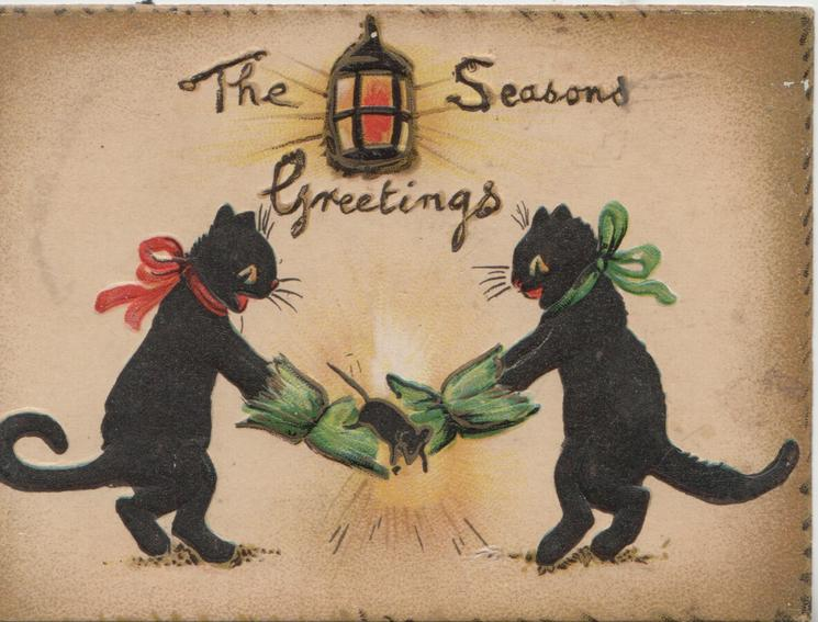 THE SEASONS GREETINGS 2 black cats pull Christmas cracker, pale brown background