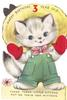HAPPY BIRTHDAY, 3 YEAR OLD die-cut cat wearing large hat, red mittens & green overalls