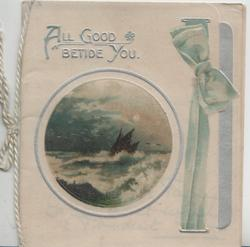 ALL GOOD BETIDE in silver above circular seascape, printed green ribbon right