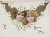 HAPPY DAYS in gilt below heads of 2 girls in gilt inset, white daisies around