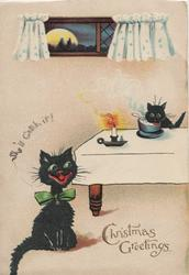 CHRISTMAS GREETINGS black cat sits facing front saying SHE'LL CATCH IT!, another eats food at table, lit candle