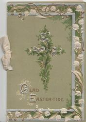 GLAD EASTER-TIDE (illuminated) in gilt below glillered fern covered cross, ornate lily-of-the valley marginal design, green background