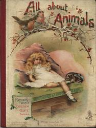 ALL ABOUT ANIMALS girl leans against pink cushions and looks up at robins on a branch