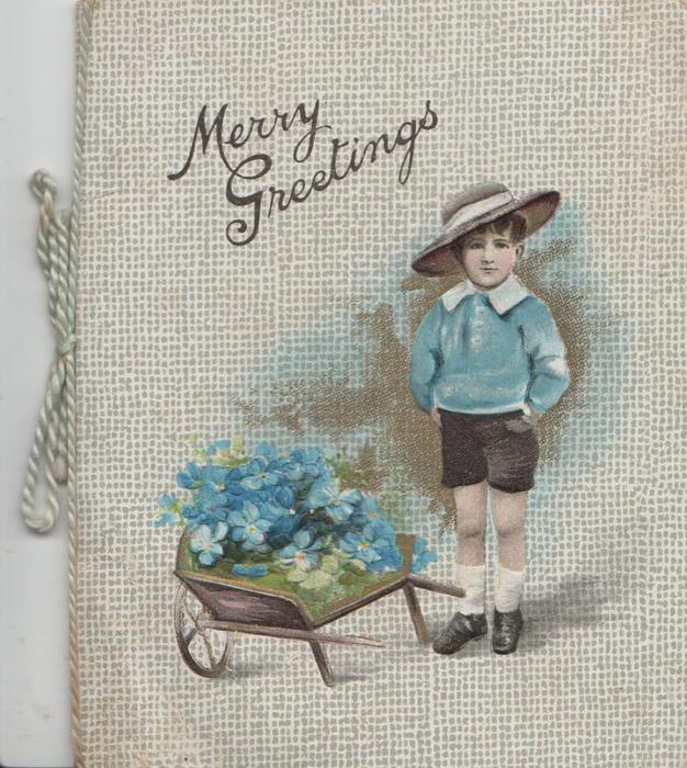 MERRY GREETINGS above boy in hat standing beside wheelbarrow of blue flowers
