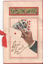 GOOD LUCK in gilt, hand holds four playing cards