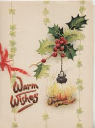 WARM WISHES in red beside berried holly above blazing log  fire, suspended cauldron above