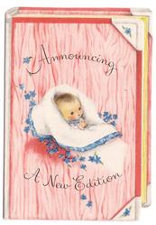 ANNOUNCING A NEW EDITION die-cut book shape in pink, baby centre with white blanket, small blue flowers