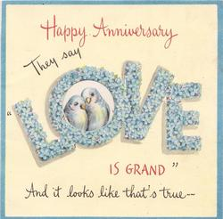 HAPPY ANNIVERSARY THEY SAY LOVE IS GRAND word 'LOVE' made from flowers, bluebirds in perforated 'O'