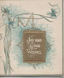JOY AND GOOD WISHES in white on gilt plaque, blue violets left & above, 3 narrow blue edges