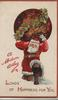 A MODERN ATLAS in red, Santa kneels under load of holly & flowers, LOADS OF HAPPINESS FOR YOU below