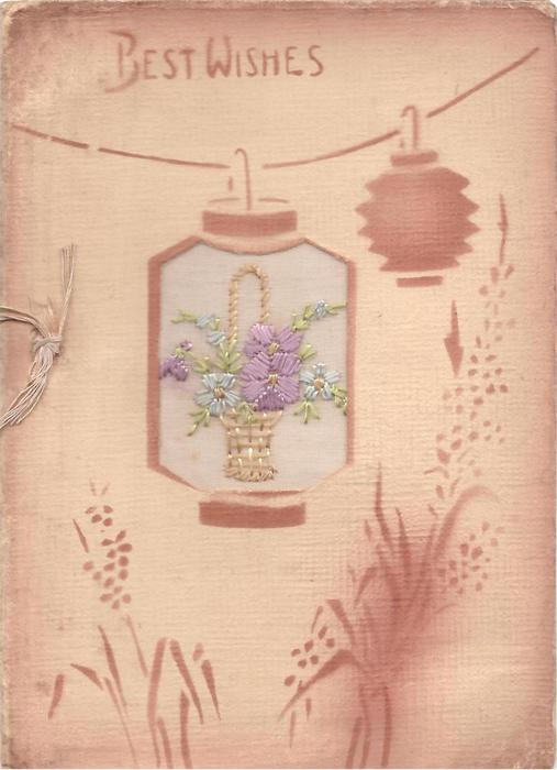 BEST WISHES above brown stencilled lanterns, one with embroidered basket of flowers inset