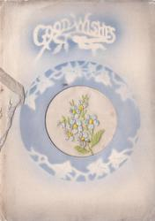 GOOD WISHES stenciled on blue above circular inset of embroidered blue flowers, stencilled ivy border on blue