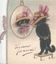 TOO SWEET FOR WORDS! black cat standing up on hind legs trying on a fancy hat in front of mirror