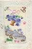 on celluloid front LOVING GREETINGS in gilt below basket of violets hanging above, white embossed floral margins