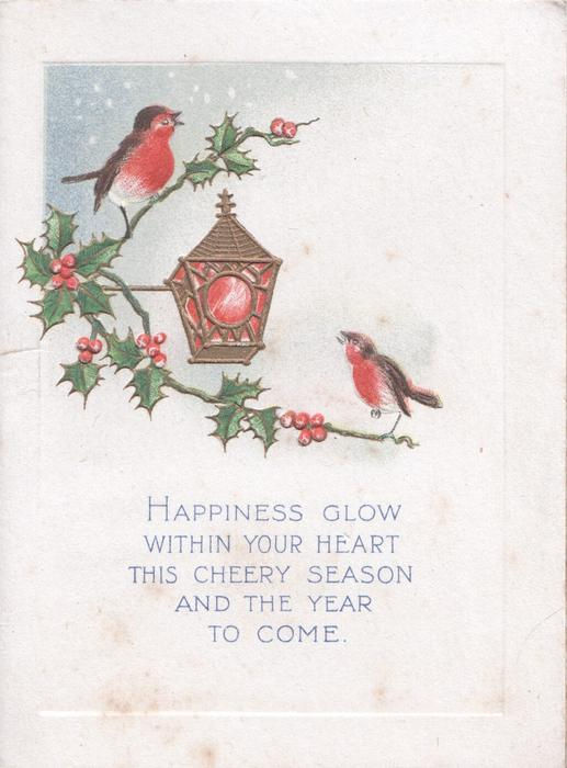 HAPPINESS GLOW.... below lantern between English robins perched on berried  holly