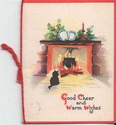 GOOD CHEERY AND WARM WISHES cat sits in front of fireplace, holly on mantle