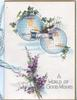 A WORLD OF GOOD WISHES bunch of heather below 2 views of the globe & clasped hands, ivy