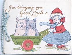I'M BRINGING YOU GOOD LUCK girl sucking on soother pushes 2 pigs in wheelbarrow