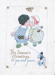 THE SEASON'S GREETING TO YOU AND YOURS, boy & girl kiss under mistletoe, dog on lead