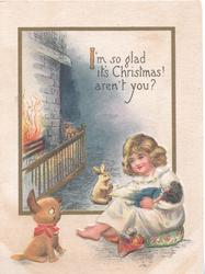 I'M SO GLAD ITS CHRISTMAS! AREN'T YOU?, girl sits by fire cuddling doll, toy cat & rabbit observe