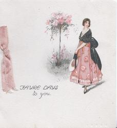 FAYRE DAYS TO YOU. girl in pink skirt stands next to pink rose bush