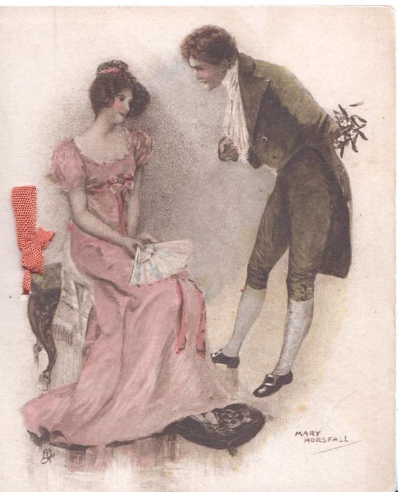 no front title,man holding mistletoe bends toward young women in pink seated left