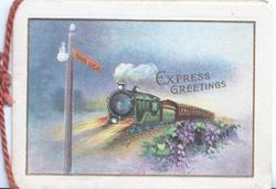 EXPRESS GREETINGS in gilt, evening scene of express train rushing left towards GOOD LUCK sign, violets right