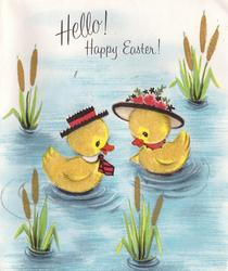 HELLO! HAPPY EASTER! pair of personised ducks face eachother on water, gilt topped bulrushes
