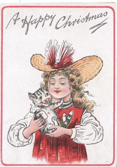 A HAPPY CHRISTMAS above standing girl cuddling kitten