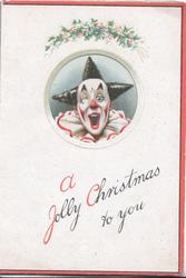 A JOLLY CHRISTMAS TO YOU holly above window to show clowns face