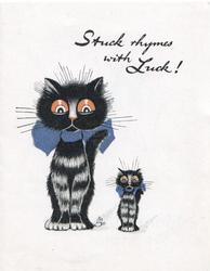 STUCK RHYMES WITH LUCK! large & small black cats sit side by side looking front