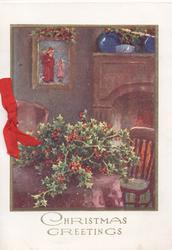 CHRISTMAS GREETINGS in silver below inset of room, much holly on table