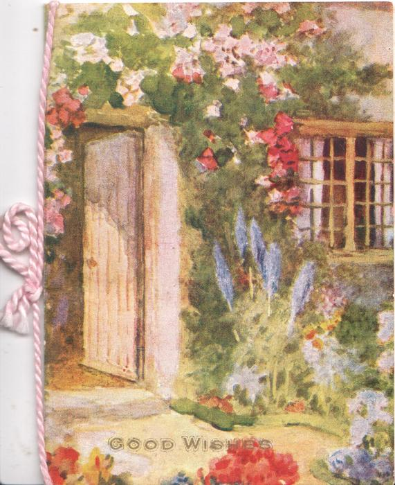 GOOD WISHES below front of cottage with garden, delphiniums, roses & other highly coloured flowers