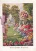 WITH BEST WISHES in gilt below garden scene, masses of multicoloured flowers, lake & rural scene behind