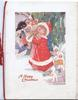A HAPPY CHRISTMAS in red below girl in red & arms full of toys with golly, helpers on ground